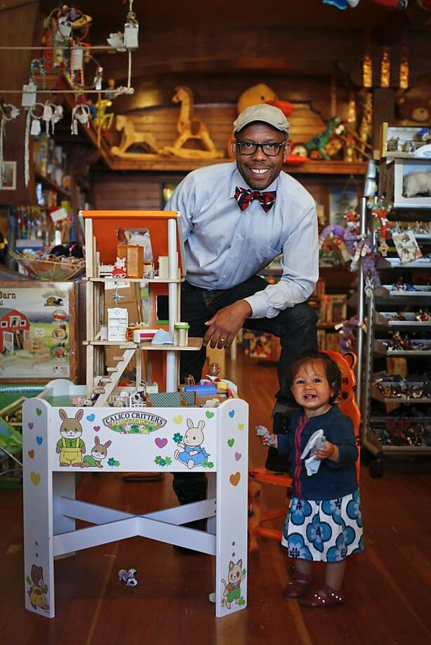 """Kenneth Wingard, host of OWN's, """"Home Made Simple,"""" and owner of SF home decor boutique, Kenneth Wingard, is seen with his daughter, Coco, 1, at The Ark toy store in San Francisco, Calif., on Friday, June 8, 2012. Photo: Russell Yip, The Chronicle"""