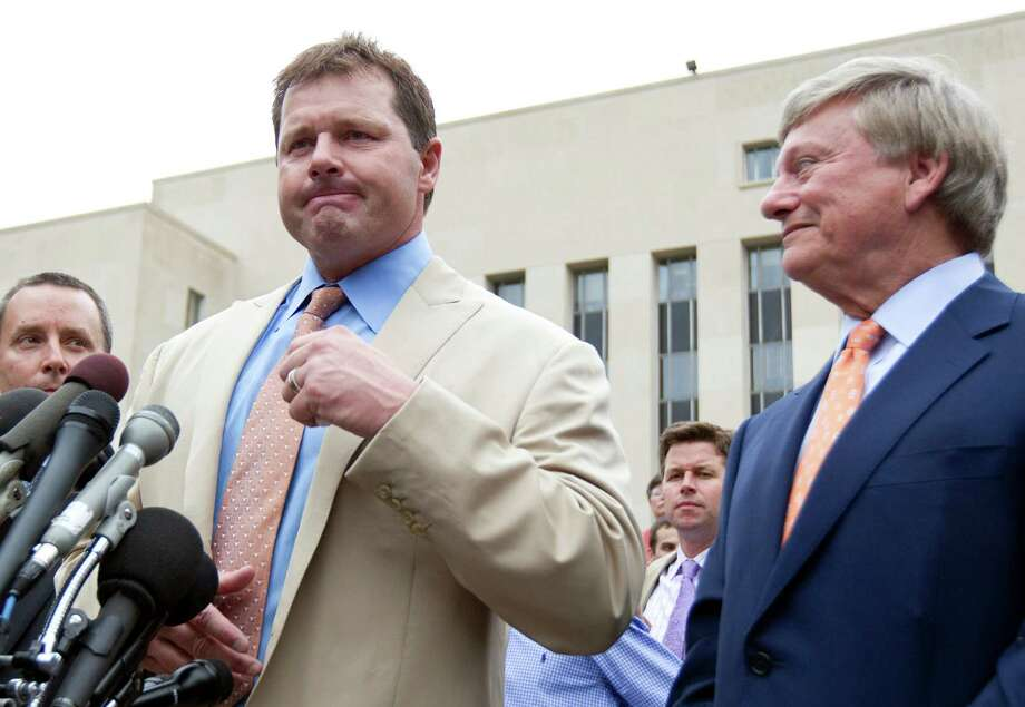 Former Major League Baseball pitcher Roger Clemens speaks to the media outside federal court in Washington, Monday, June 18, 2012, as his attorney Rusty Hardin listens, after Clemens was acquitted on all charges by a jury that decided that he didn't lie to Congress when he denied using performance -enhancing drugs. Photo: AP