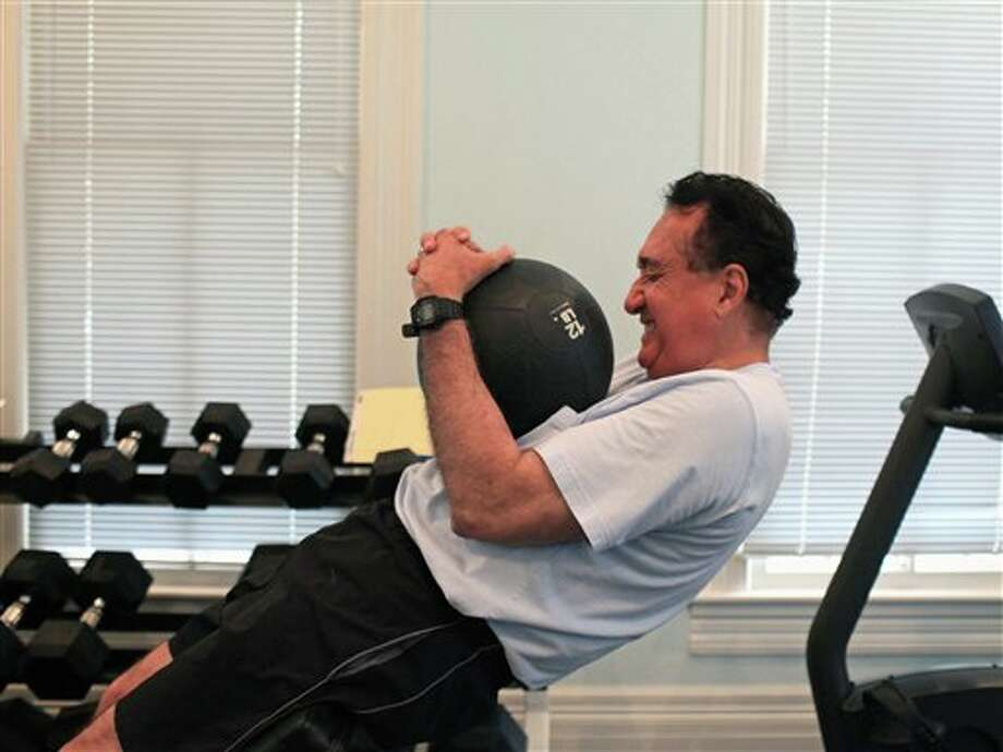 In this June 12, 2012, photo, Henry Cisneros does his core routine as he exercises at his home in San Antonio. Cisneros, who served as housing secretary under President Bill Clinton, says he has been diagnosed with early-stage prostate cancer but expects to beat the disease with nine weeks of radiation therapy. Photo: Lisa Krantz, AP / 2012 San Antonio Express-News