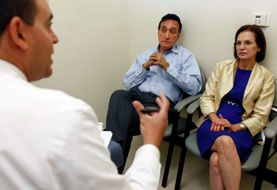 In this June 12, 2012, photo, Dr. Michael A. Selva, left, a radiation oncologist, answers questions from Henry Cisneros and his wife, Mary Alice, before his daily radiation treatment at San Antonio Center for Cancer Treatment in San Antonio. Cisneros, who served as housing secretary under President Bill Clinton, says he has been diagnosed with early-stage prostate cancer but expects to beat the disease with nine weeks of radiation therapy. Photo: AP