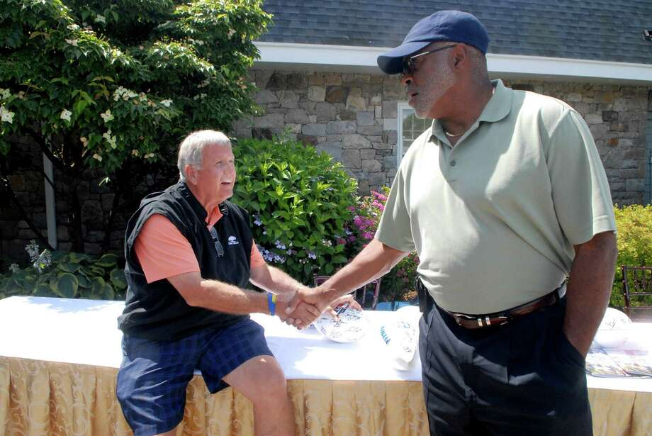 Tommy John and Richard Caster at the NFL Alumni CT Chapter 6th Annual Charity Golf Classic at Country Club of Darien in Darien, Conn. on Monday June 18, 2012. Photo: Dru Nadler / Stamford Advocate Freelance