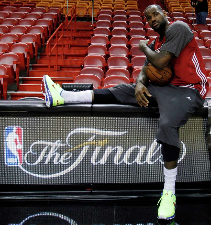 Heat forward LeBron James takes a break during practice on Monday. James is averaging 30.3 points, 10.3 rebounds and 4.0 assists in this year's Finals. Photo: Alan Diaz, Associated Press