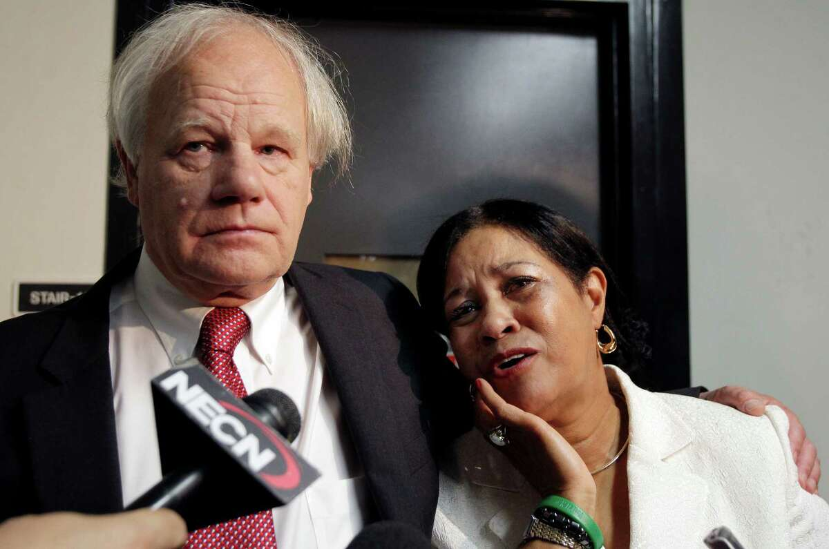 Nicolas and Virginia Payne, of New Milford, Conn., react as they speak to media about their slain daughter, Rebecca, outside a Suffolk Superior Courtroom in Boston, Monday, June 18, 2012, after Cornell Smith, 30, was arraigned on first-degree murder charges in her shooting death. (AP Photo/Elise Amendola)