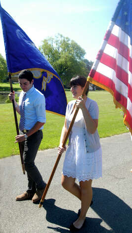 Junior marshals Ian Bowman and Emily Deanne bear the colors during Shepaug Valley High School's Class of 2012 graduation ceremony, June 16, 2012, in Washington. Photo: Norm Cummings