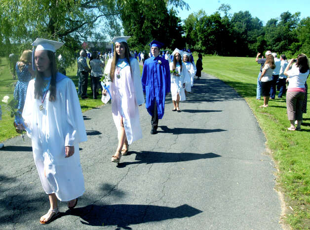 Leading the processional for the Shepaug Valley High School Class of 2012 graduation ceremony, June 16, 2012, in Washington are class president and salutatorian Gina DeMeo and valedictorian Jenni Isaac.. Photo: Norm Cummings