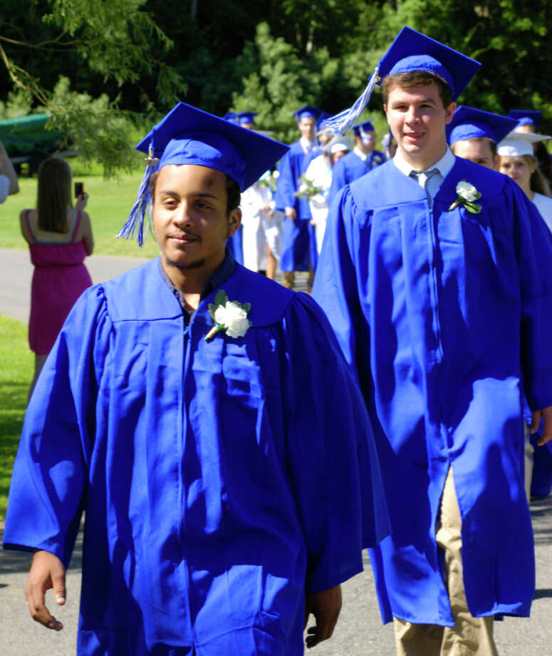 Jeff Lewis, left, and Kyle Lundie march in the processional for the Shepaug Valley High School Class of 2012 graduation ceremony, June 16, 2012, in Washington. Photo: Norm Cummings