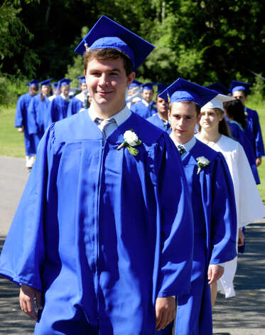 Kyle Lundie, left, Shaun Lynch and classmates march in the processional for the Shepaug Valley High School Class of 2012 graduation ceremony, June 16, 2012, in Washington. Photo: Norm Cummings