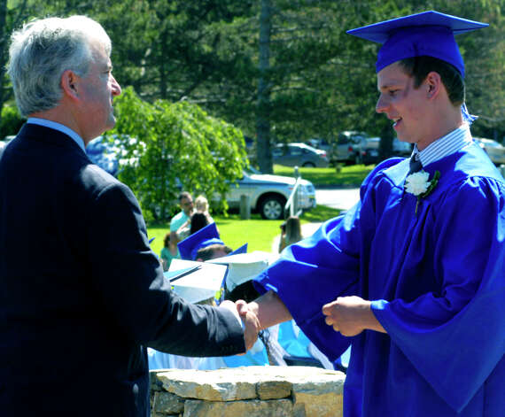 Class of 2012 member Zach Drzal receives his diploma Saturday from Region 12 Board of Education Chairman James Hirschfield during the Shepaug Valley High School graduation ceremony, June 16, 2012, in Washington. Photo: Norm Cummings