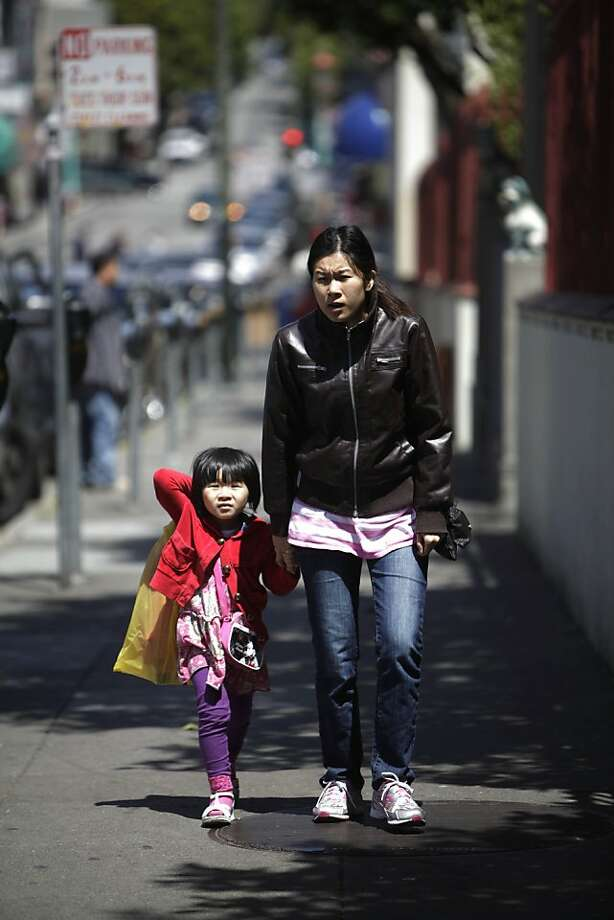 Lillian Lin (right) walks up Pacific Avenue with her daughter Monli Tan, 5, on their way to visit a relative on Monday, June 18, 2012 in San Francisco, Calif. Photo: Lea Suzuki, The Chronicle