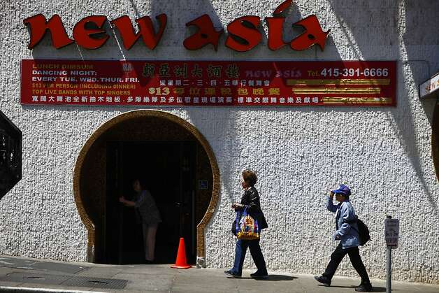 Pedestrians walk past the New Asia restaurant on Monday, June 18, 2012 in San Francisco, Calif. Photo: Lea Suzuki, The Chronicle