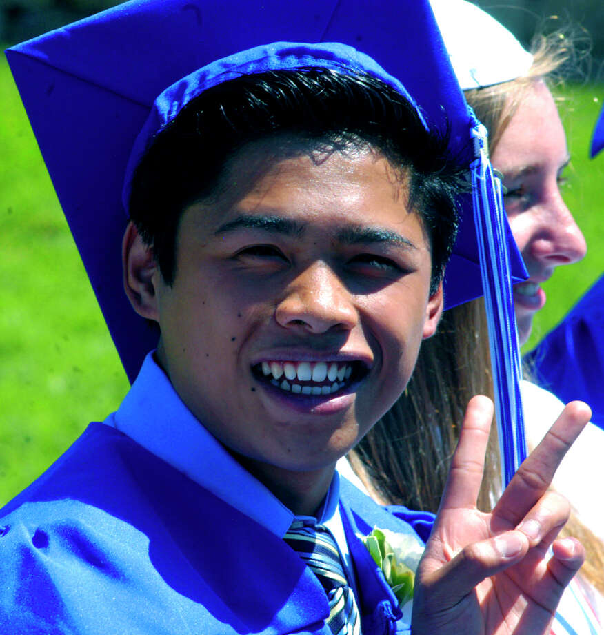 Adam Hiravy is clearly upbeat as he experiences the Shepaug Valley High School graduation ceremony, June 16, 2012, in Washington. Photo: Norm Cummings