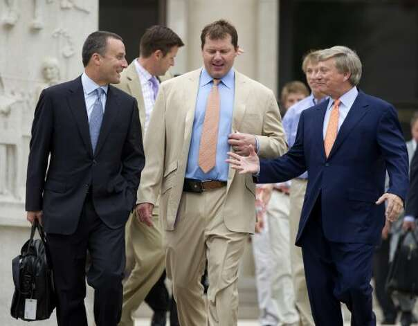 June 18 Former major league pitcher Roger Clemens, center, walks with his lawyers Rusty Hardin, right, and Michael Attanasio, left, outside federal court in Washington on Monday. Clemens was acquitted on all charges by a jury that decided that he didn't lie to Congress when he denied using performance-enhancing drugs. (Manuel Balce Ceneta / Associated Press)