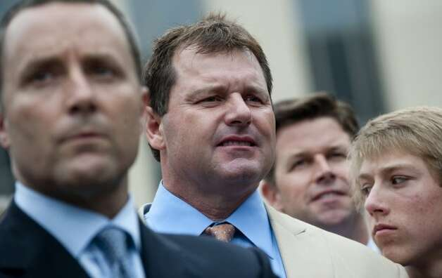 Roger Clemens waits to speak to the media alongside attorney Michael Attanasio. (SAUL LOEB / AFP/Getty Images)