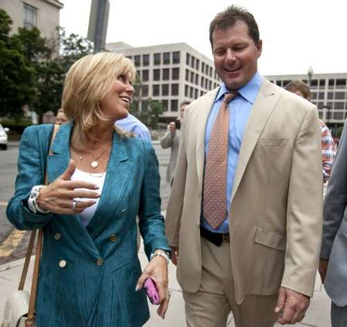 Debbie Clemens, left, smiles while leaving federal court with her husband, Roger, after he was acquitted on all charges by a jury that decided that he didn't lie to Congress when he denied using performance-enhancing drugs.  (Jacquelyn Martin / Associated Press)