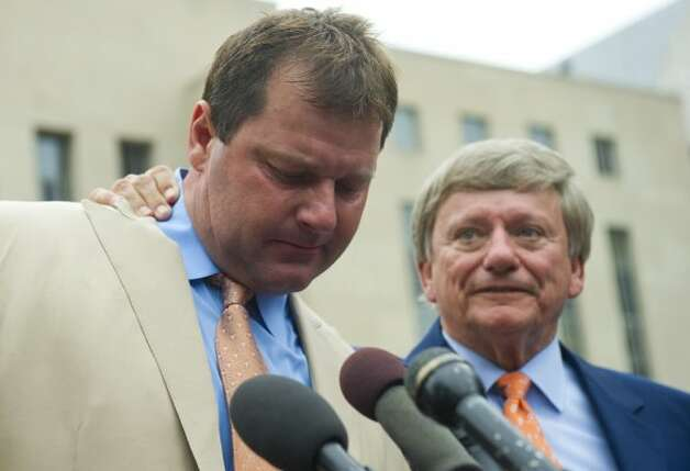 Roger Clemens speaks to the media alongside his attorney, Rusty Hardin, after he was found not guilty on all charges in his perjury trial. (SAUL LOEB / AFP/Getty Images)