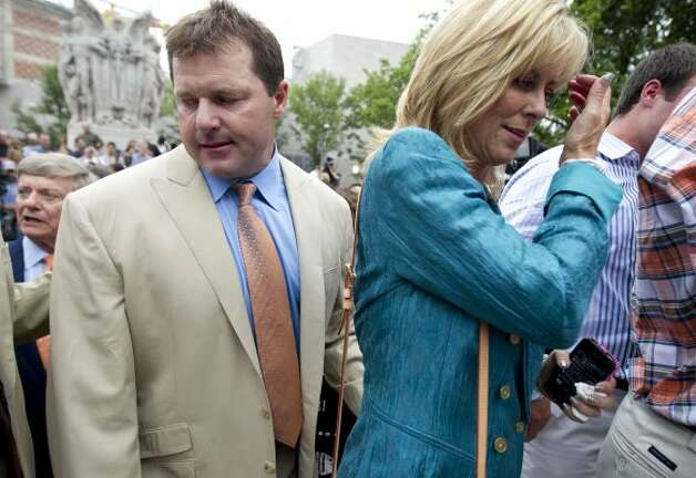Roger Clemens and his wife, Debbie, leave a news conference outside federal court in Washington. (Manuel Balce Ceneta / Associated Press)