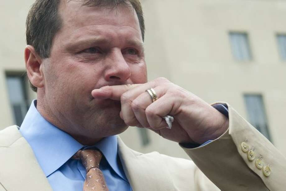 Roger Clemens becomes emotional as he speaks to the media after he was found not guilty on all charges in his perjury trial. (SAUL LOEB / AFP/Getty Images)