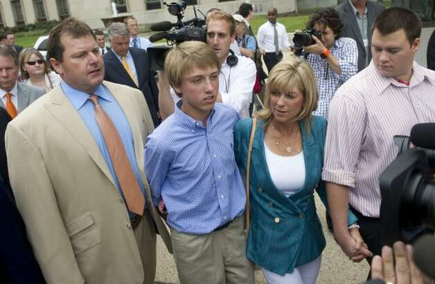 Roger Clemens, left, leaves after speaking to the media after he was found not guilty on all charges in his perjury trial. (SAUL LOEB / AFP/Getty Images)