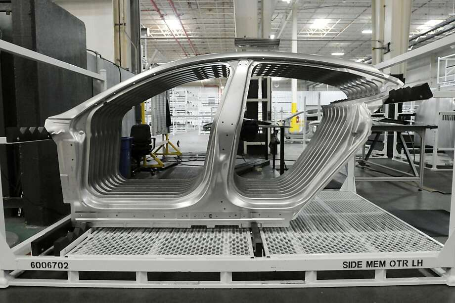 Side door panels for the Tesla Model S sedan wait for assembly at the Tesla factory in Fremont, Calif., Wednesday, June 13, 2012. Photo: Erik Verduzco, Special To The Chronicle