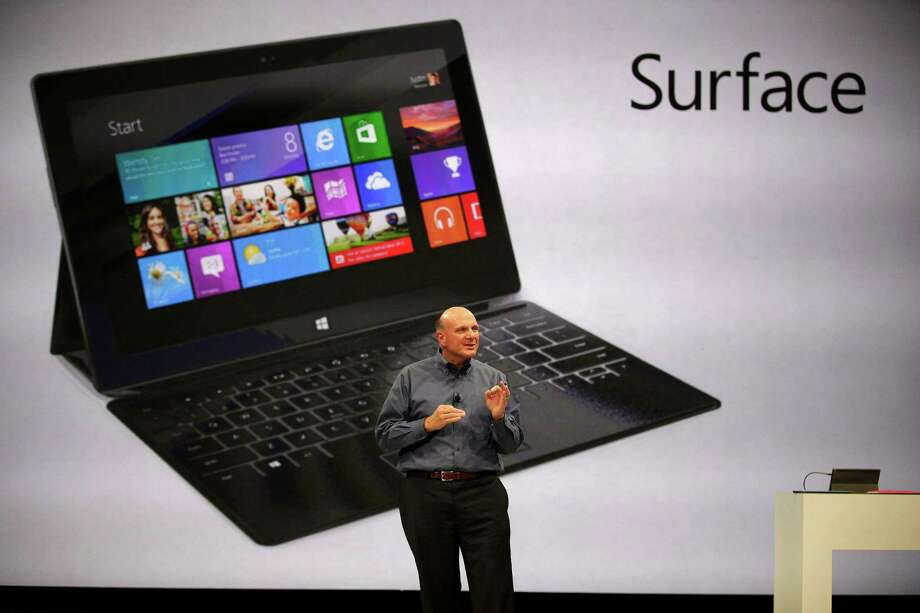 "Microsoft CEO Steve Ballmer unveils ""Surface"", a new tablet computer to compete with Apple's iPad, at Hollywood's Milk Studios in Los Angeles Monday, June 18, 2012. The 9.3 millimeter thick tablet comes with a kickstand to hold it upright and keyboard that is part of the device's cover. It weighs under 1.5 pounds. Photo: AP"