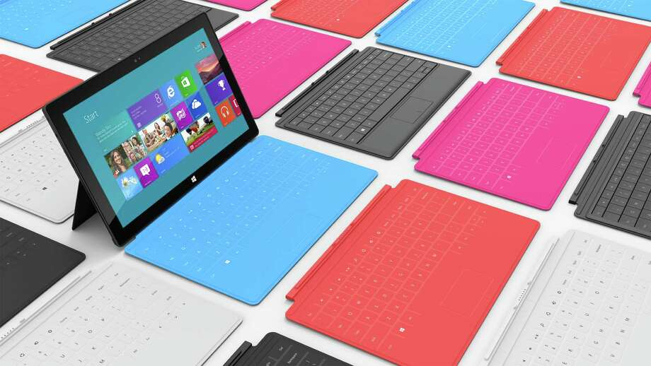 This product rendering released by Microsoft shows Surface, a 9.3 millimeter thick tablet with a kickstand to hold it upright and keyboard that is part of the device's cover. It weighs under 1.5 pounds. The device is part of the software company's effort to compete with Apple Inc. and its popular iPad tablet computer. Photo: AP