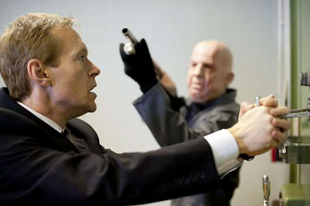 Inside Men, Season 1, Episode 1, John (Steven Mackintosh) and a gangster Photo: Nick Wall, BBC America