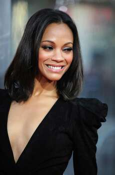 """Actress Zoe Saldana arrives at the premiere of """"The Losers"""" in Hollywood, California, on April 20, 2010. AFP PHOTO / GABRIEL BOUYS (Photo credit should read GABRIEL BOUYS/AFP/Getty Images) Photo: GABRIEL BOUYS / AFP"""