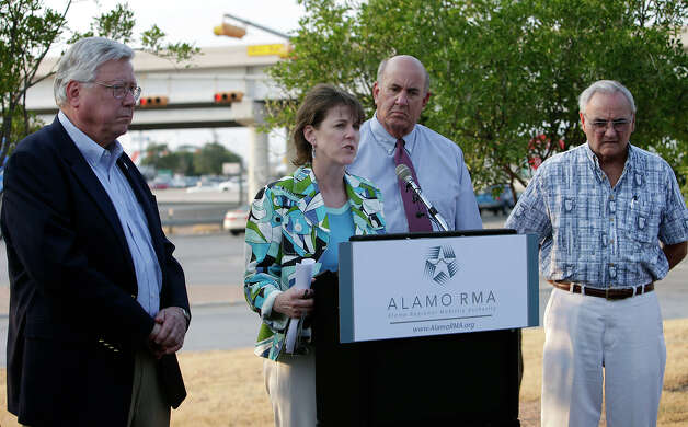 Alamo Regional Mobility Authority Executive Director Terry Brechtel (center) joined by board members William Thornton (far left), Jim Reed and Arthur Downey (far right) hold a press conference to decry the recent lawsuit filed by environmentalist group Aquifer Guardians in Urban Areas against the Alamo Regional Mobility Authority to stop a proposed interchange at the 281/1604 intersection. Photo: KIN MAN HUI, SAN ANTONIO EXPRESS-NEWS / kmhui@express-news.net