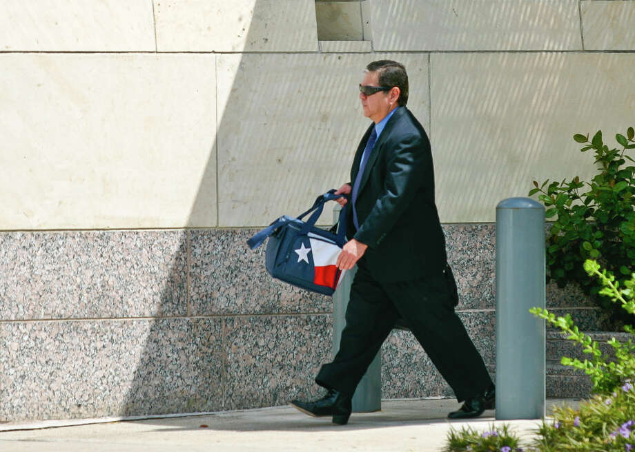 Ray Marchan exits the federal courthouse on Monday, June 18, 2012, in Brownsville, Texas. Marchan, a Port Isabel attorney accused in judicial kickbacks probe, was found guilty on all seven counts he faced, U.S District Judge Andrew Hanen ruled Marchan remain free on bond. Photo: Yvette Vela, AP / Yvette Vela