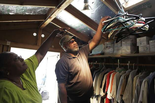 "Barbara and Bill Gibson of Antioch return a hanger to a rack while using the Clothing Shed at Fresh Start on Thursday, June 14, 2012 in Walnut Creek, Calif. The Gibson's are not homeless but are ""threatened"" Barbara Gibson said. Photo: Lea Suzuki, The Chronicle"
