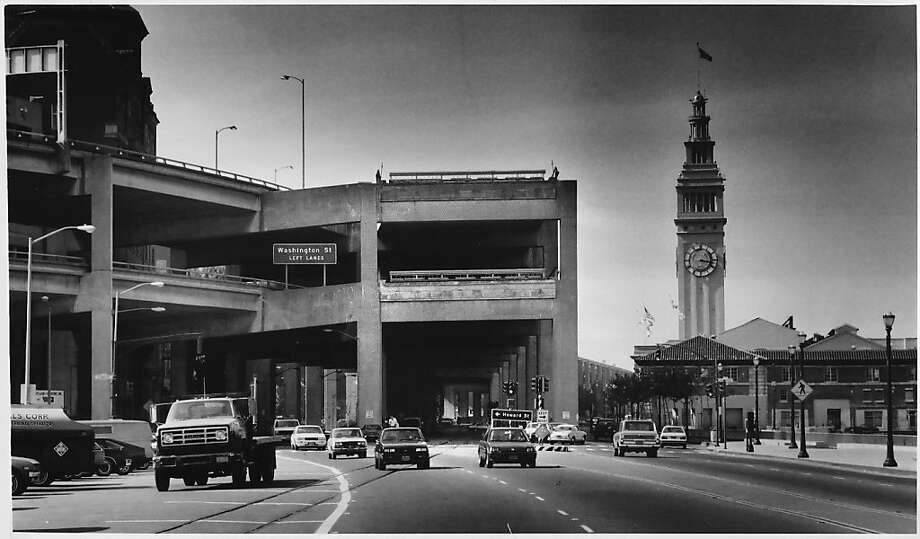 The elevated Embarcadero Freeway severed the Ferry Building from Market Street for 31 years until it was demolished in 1990. An influential report drafted in 1937 called for elevating Van Ness Avenue as well. Photo: Gary Fong, Chronicle Staff