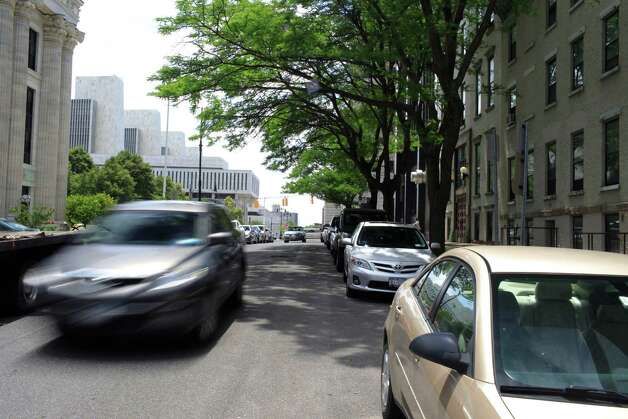 Cars parked on South Swan St. street in Albany, N.Y., Monday June 18, 2012. Albany Common Council is expected to vote Monday night on resident permit parking system. (Dan Little / Special to the Times Union) Photo: Daniel Little / 00018142A