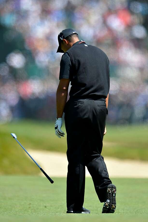 SAN FRANCISCO, CA - JUNE 15:  Tiger Woods of the United States reacts to a poor shot on the sixth hole during the second round of the 112th U.S. Open at The Olympic Club on June 15, 2012 in San Francisco, California.  (Photo by Stuart Franklin/Getty Images) Photo: Stuart Franklin, Getty Images