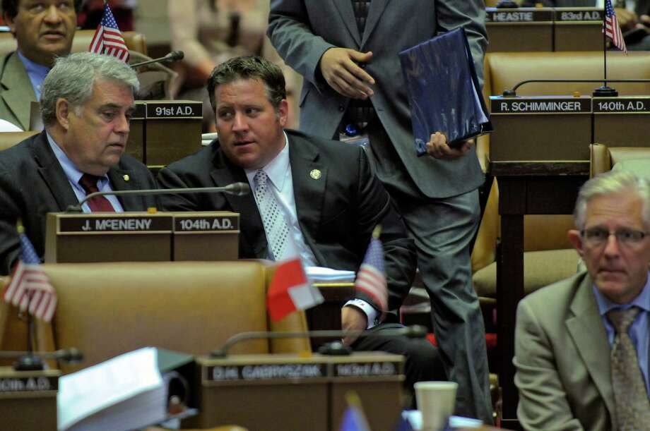 Assemblyman Jack McEneny, left, talks with Albany County Executive Dan McCoy as he visits the Assembly chamber on the start of the last week of the legislative session, on Monday afternoon June 18, 2012 in Albany, NY. (Philip Kamrass / Times Union) Photo: Philip Kamrass / 00018143A