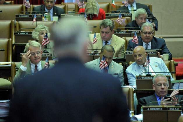 Legislators gather in the Assembly chamber on the start of the last week of the legislative session, on Monday afternoon June 18, 2012 in Albany, NY. (Philip Kamrass / Times Union) Photo: Philip Kamrass / 00018143A