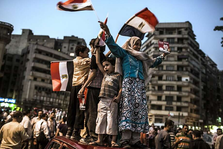 CAIRO, EGYPT - JUNE 18: Children wave flags as they and other Egyptian supporters celebrate a premature victory for their presidential candidate Mohamed Morsi in Tahrir Square on June 18, 2012 in Cairo, Egypt. Egyptian candidates Mohamed Morsi and Ahmed Shafiq contested in the second round of voting for the country's president held over two days of voting last weekend. Despite official results not having been announced, the Muslim Brotherhood are claiming victory for their presidential candidate Mohamed Morsi. (Photo by Daniel Berehulak /Getty Images)  *** BESTPIX *** Photo: Daniel Berehulak, Getty Images