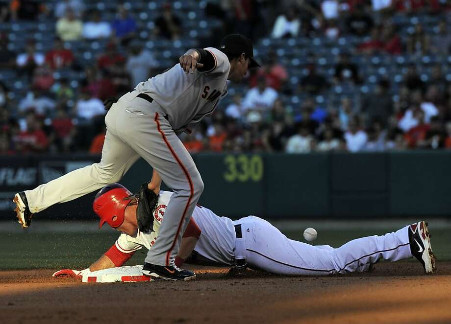 Los Angeles Angels Mike Trout steals second base against San Francisco Giants' Ryan Theriot in the first inning, Monday, June 18, 2012, at Angel Stadium in Anaheim, California. (Rose Palmisano/Orange County Register/MCT) Photo: Rose Palmisano, McClatchy-Tribune News Service