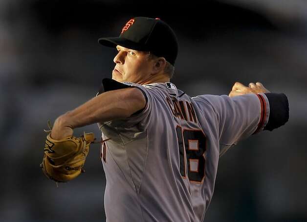 San Francisco Giants starting pitcher Matt Cain throws to the Los Angeles Angels during the first inning of a baseball game in Anaheim, Calif., Monday, June 18, 2012. (AP Photo/Chris Carlson) Photo: Chris Carlson, Associated Press