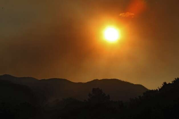 The sun sets amidst smoke from the High Park Fire near Bellvue,  Colo., on Monday,  June 18, 2012. The wildfire has now burned about 90 square miles and destroyed more than 180 homes. (AP Photo/Ed Andrieski) Photo: Ed Andrieski, Associated Press