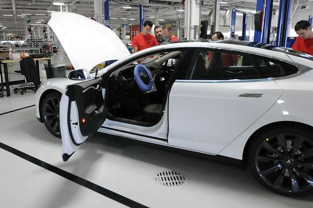 A completed Tesla Model S sedan sits at the end of the assembly line at Tesla's factory in Fremont, Calif., Wednesday, June 13, 2012. On June 22, Tesla Motors will begin delivering its all-electric Model S luxury sedan. It is only the second car ever produced by Tesla, and first to be built at Tesla's own factory. Photo: Erik Verduzco, Special To The Chronicle