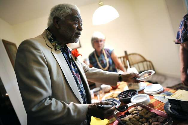 Jim McWilliams, of Oakland, hands out cherry cobbler to guests attending a birthday party for Susan Sherrell at her home in Oakland CA Saturday June 16th, 2012 Photo: Michael Short, Special To The Chronicle
