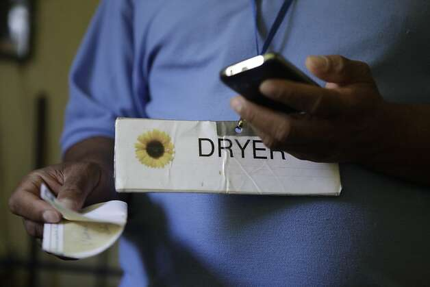 Paul Harrell, who is homeless, wears a tag to indicate he has use of the dryer in the laundry room as he calls a friend he referred to Fresh Start with driving directions at Fresh Start on Thursday, June 14, 2012 in Walnut Creek, Calif. Photo: Lea Suzuki, The Chronicle
