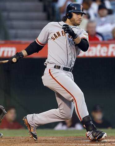 San Francisco Giants' Brandon Crawford watches his two-run triple against the Los Angeles Angels during the second inning of a baseball game in Anaheim, Calif., Monday, June 18, 2012. (AP Photo/Chris Carlson) Photo: Chris Carlson, Associated Press