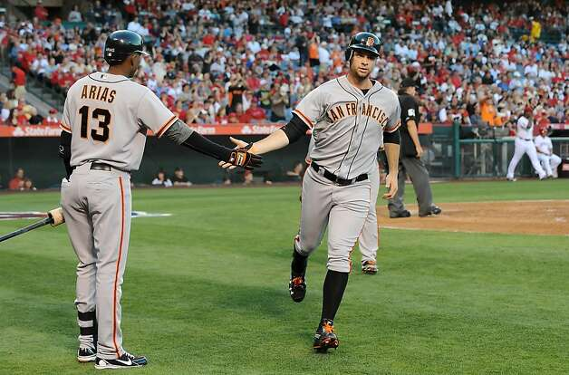 ANAHEIM, CA - JUNE 18:  Brandon Belt #9 of the San Francisco Giants scores in the second inning against the Los Angeles Angels of Anaheim at Angel Stadium of Anaheim on June 18, 2012 in Anaheim, California.  (Photo by Lisa Blumenfeld/Getty Images) Photo: Lisa Blumenfeld, Getty Images