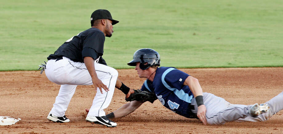 Missions' Jeudy Valdez tags out Hooks' Drew Muren trying to steal second during the second inning Monday, June 18, 2012 at Nelson Wolff Municipal Stadium. Photo: Edward A. Ornelas, San Antonio Express-News / © 2012 San Antonio Express-News