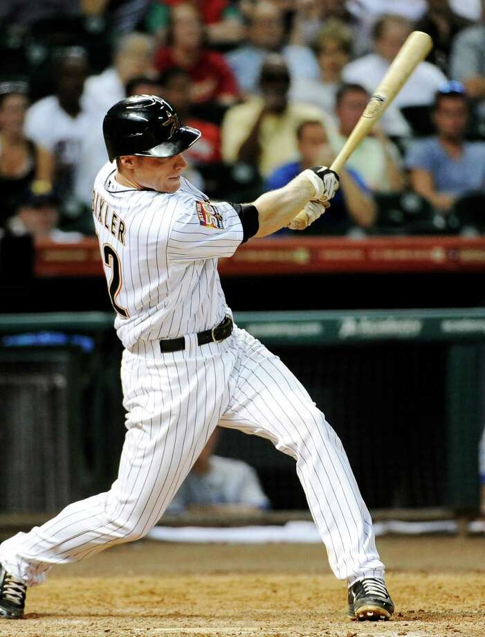 Houston Astros' Brian Bixler swings for a two-run double against the Kansas City Royals in the eighth inning of an interleague baseball game, Monday, June 18, 2012, in Houston. The Astros won 9-7. Photo: Pat Sullivan, Associated Press