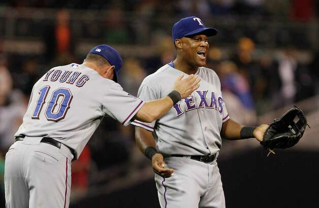 Texas Rangers' Adrian Beltre, right, and Michael Young celebrate after the Rangers' 2-1 victory over the San Diego Padres in a baseball game Monday, June 18, 2012 in San Diego. Photo: Lenny Ignelzi, Associated Press