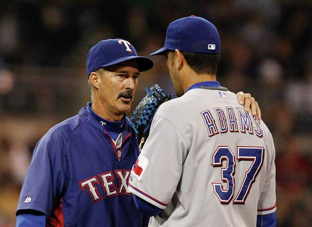Texas Rangers pitching coach Mike Maddux settles down Texas Rangers relief pitcher Mike Adams during a jam against the San Diego Padres in the eighth inning of a baseball game Monday, June 18, 2012 in San Diego. Photo: Lenny Ignelzi, Associated Press