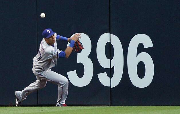 Texas Rangers center fielder Leonys Martin misplays the carom off the centerfield wall on a double hit by San Diego Padres' Chase Headley  during the first  inning of an interleague baseball game, Monday, June 18, 2012, in San Diego. Photo: Lenny Ignelzi, Associated Press