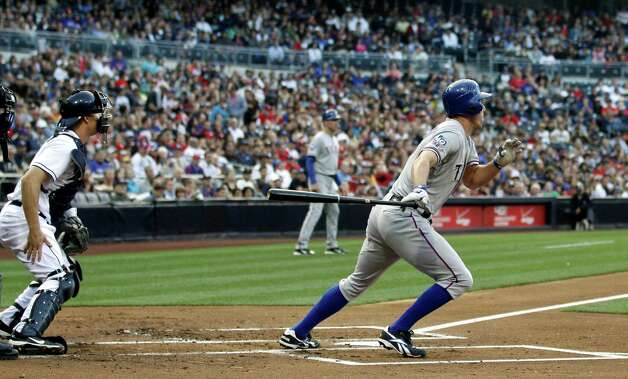 Texas Rangers' David Murphy, right, grounds a two run single up the middle against the San Diego Padres during the first inning of an interleague baseball game, Monday, June 18, 2012, in San Diego. Photo: Lenny Ignelzi, Associated Press